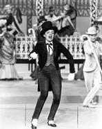 Judy Garland - Judy Garland dancing in a top hat