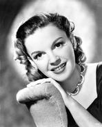 Judy Garland - Judy Garland leaning on a Chair and wearing a Necklace in a Portrait