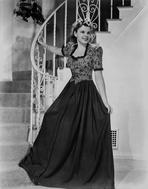 Judy Garland - Judy Garland in an amazing dress at the bottom of spiral stair case