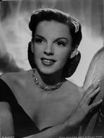 Judy Garland - Judy Garland posed with a necklace