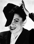 Judy Garland - Judy Garland portrait with tipped hat on head