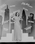 Judy Garland - Judy Garland dancing infront of shadows of skyline +tograph High...