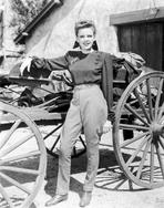 Judy Garland - Judy Garland next to wagon