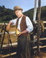 Laramie - Laramie Cast Member in Cowboy Outfit Holding a Brush