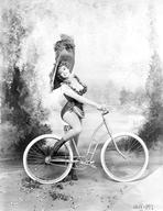 Marilyn Monroe - Marilyn Monroe wearing Corset on Bicycle with Hat
