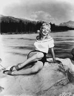Marilyn Monroe - Marilyn Monroe Posed on Rock at Lake