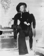 Marlene Dietrich - Marlene Dietrich standing in Black Dress with Black Shawl