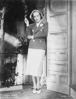 Marlene Dietrich - Marlene Dietrich standing in Police Uniform with Cigarette