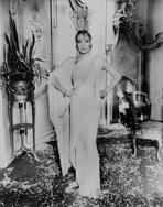 Marlene Dietrich - Marlene Dietrich standing in Classic Gown with Hands on Hips