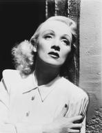 Marlene Dietrich - Marlene Dietrich Leaning on Wall, wearing White Neat Blouse