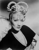 Marlene Dietrich - Marlene Dietrich Posed in Black Dress with Braided Hairstyle