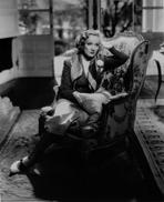 Marlene Dietrich - Marlene Dietrich sitting on Couch, wearing Black Dress with Head Leaning on Hand