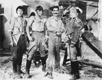 Marx Brothers - Marx Brothers standing with Construction Outfit with a Soldier- Photograph Print