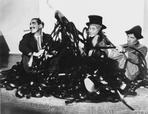 Marx Brothers - Marx Brothers Scene with Three Men smiling in Black and White
