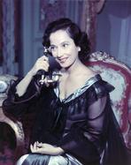 Merle Oberon - Merle Oberon in Black Gown With Telephone Portrait