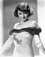 Myrna Loy - Myrna Loy posed in White Gown