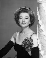 Myrna Loy - Myrna Loy Posed in Black and White with Corsage