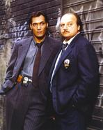 NYPD Blue - NYPD Blue standing Posed in Tuxedo with Badge