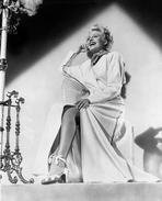 Rita Hayworth - Rita Hayworth Leaning in a Crossed Legs Pose