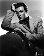 Robert Taylor - Robert Taylor posed in Suit with Head Leaning on Hand
