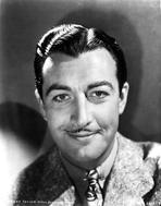 Robert Taylor - Robert Taylor smiling in Suit