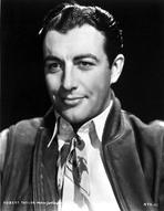 Robert Taylor - Robert Taylor smiling in White Shirt and Vest