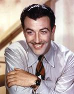 Robert Taylor - Robert Taylor smiling in Shirt and Tie