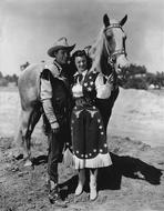 Roy Rogers Collection - Roy Rogers posed with Girl and A Horse in Black and White
