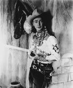 Roy Rogers Collection - Roy Rogers Leaning on Wall in Cowboy Outfit