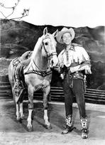 Roy Rogers Collection - Roy Rogers posed with Horse in Cowboy Outfit