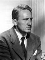 Spencer Tracy - Spencer Tracy Cast Member Looking Away wearing Formal Suit in Black and White Portrait