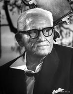 Spencer Tracy - Spencer Tracy Cast Member Looking Away wearing Formal Suit with Eyeglasses in Black and White Portrait